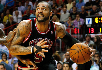 MIAMI, FL - APRIL 19: Carlos Boozer #5 of the Chicago Bulls drives during a game against the Miami Heat at American Airlines Arena on April 19, 2012 in Miami, Florida. NOTE TO USER: User expressly acknowledges and agrees that, by downloading and/or using