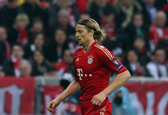 MUNICH, GERMANY - APRIL 03: Anatoliy Tymoshchuk of Muenchen runs with the ball during the UEFA Champions League quarter-final second leg match at Allianz Arena on April 3, 2012 in Munich, Germany.  (Photo by Martin Rose/Bongarts/Getty Images)