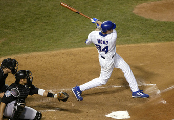 CHICAGO - OCTOBER 15:  Kerry Wood #34 of the Chicago Cubs hits a three-run home run in the second inning against the Florida Marlins  during game seven of the National League Championship Series October 15, 2003 at Wrigley Field in Chicago, Illinois.  (Ph