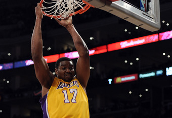 LOS ANGELES, CA - APRIL 06:  Andrew Bynum #17 of the Los Angeles Lakers dunks against the Houston Rockets at Staples Center on April 6, 2012 in Los Angeles, California.  NOTE TO USER: User expressly acknowledges and agrees that, by downloading and or usin