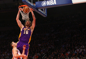 NEW YORK, NY - FEBRUARY 10:  Pau Gasol #16 of the Los Angeles Lakers dunks in the second quarter against Jeremy Lin #17 of the New York Knicks at Madison Square Garden on February 10, 2012 in New York City.  NOTE TO USER: User expressly acknowledges and a