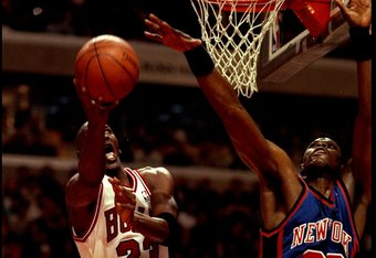 5 May 1996:  Guard Michael Jordan of the Chicago Bulls takes a shot against center Patrick Ewing of the New York Knicks during a game played at the United Center in Chicago, Illinois.  The Bulls won the game, 91-84. Mandatory Credit: Doug Pensinger/Allspo