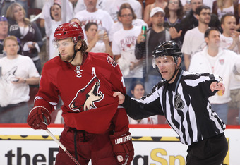 GLENDALE, AZ - MAY 15:  Linesman Brian Murphy #93 gets hold of Martin Hanzal #11 of the Phoenix Coyotes after Hanzal boarded Dustin Brown #23 of the Los Angeles Kings in the third period of Game Two of the Western Conference Final during the 2012 NHL Stan