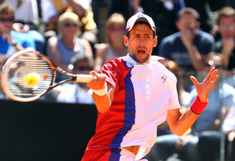 ROME, ITALY - MAY 17:  Novak Djokovic of Serbia plays a forehand in his match against Juan Monaco of Argentina during day six of the Internazionali BNL d'Italia 2012 Tennis on May 17, 2012 in Rome, Italy.  (Photo by Julian Finney/Getty Images)