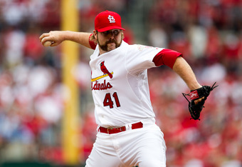 ST. LOUIS, MO - APRIL 28: Mitchell Boggs #41 of the St. Louis Cardinals delivers a pitch during a game against the Milwaukee Brewers at Busch Stadium on April 28, 2012 in St. Louis, Missouri. The St. Louis Cardinals beat the Milwaukee Brewers 7-3. (Photo