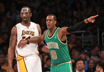 LOS ANGELES, CA - MARCH 11:  Rajon Rondo #9 of the Boston Celtics signals as he sets up against Kobe Bryant #24 of the Los Angeles Lakers at Staples Center on March 11, 2012 in Los Angeles, California.  The Lakers won 97-94.  NOTE TO USER: User expressly