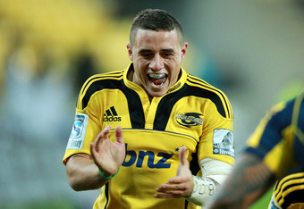 WELLINGTON, NEW ZEALAND - MAY 18:  TJ Perenara of the Hurricanes celebrates a try during the round 13 Super Rugby match between the Hurricanes and the Brumbies at Westpac Stadium on May 18, 2012 in Wellington, New Zealand.  (Photo by Hagen Hopkins/Getty I