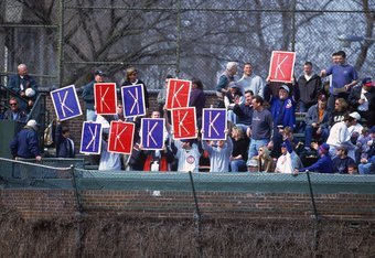4 Apr 2001:  Fans of Kerry Wood #34 of the Chicago Cubs track his strike-outs during the game against the Montreal Expos at Wrigley Field in Chicago, Illinois.  The Expos defeated the Cubs 3-2.Mandatory Credit: Jonathan Daniel  /Allsport