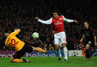 LONDON, ENGLAND - MARCH 06:  Christian Abbiati of AC Milan saves Robin van Persie of Arsenal's close range effort on goal during the UEFA Champions League Round of 16 second leg match between Arsenal and AC Milan at Emirates Stadium on March 6, 2012 in Lo