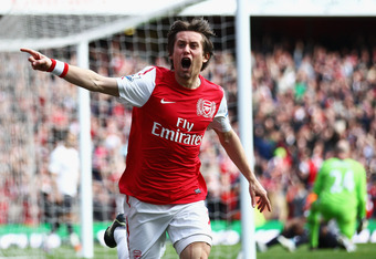 LONDON, ENGLAND - FEBRUARY 26:  Tomas Rosicky of Arsenal celebrates his goal during the Barclays Premier League match between Arsenal and Tottenham Hotspur at Emirates Stadium on February 26, 2012 in London, England.  (Photo by Clive Mason/Getty Images)
