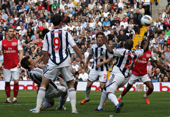 WEST BROMWICH, ENGLAND - MAY 13:  Laurent Koscielny (hidden) of Arsenal scores during the Barclays Premier League match between West Bromwich Albion and Arsenal at The Hawthorns on May 13, 2012 in West Bromwich, England.  (Photo by Ross Kinnaird/Getty Ima