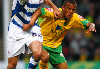 NORWICH, ENGLAND - APRIL 27:  Ryan Bertrand (R) of Norwich battles with Glen Little of Reading during the Coca-Cola Championship match between Norwich City and Reading at Carrow Road on April 27, 2009 in Norwich, England.  (Photo by Jamie McDonald/Getty I