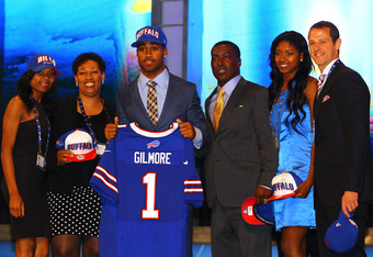 NEW YORK, NY - APRIL 26:  Stephon Gilmore of South Carolina holds up a jersey as he poses on stage with family after he was selected #10 overall by the Buffalo Bills in the first round of the 2012 NFL Draft at Radio City Music Hall on April 26, 2012 in Ne