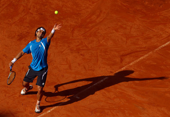 ROME, ITALY - MAY 19:  David Ferrer of Spain serves to Rafael Nadal of Spain during day eight of the Internazionali BNL d'Italia 2012 Tennis on May 19, 2012 in Rome, Italy.  (Photo by Julian Finney/Getty Images)