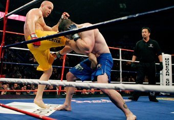 UNCASVILLE, CT - DECEMBER 29:  Aaron Stark (blue) fights Mike Ciesnolevicz (yellow) during the International Fight League World Team Championship Final at the Mohegan Sun Arena on December 29, 2006 in Uncasville, Connecticut.  (Photo by Brian Bahr/Getty I