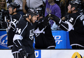 LOS ANGELES, CA - MAY 17:  Dwight King #74 of the Los Angeles Kings celebrates with Matt Greene #2 after scoring a third period goal against the Phoenix Coyotes in Game Three of the Western Conference Final during the 2012 NHL Stanley Cup Playoffs at Stap
