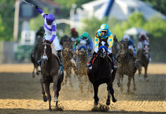 BALTIMORE, MD - MAY 19: I'll Have Another ridden by Mario Gutierrez (L) beats Bodemeister ridden by Mike E. Smith at the finish line to win the 137th running of the Preakness Stakes at Pimlico Race Course on May 19, 2012 in Baltimore, Maryland. (Photo by