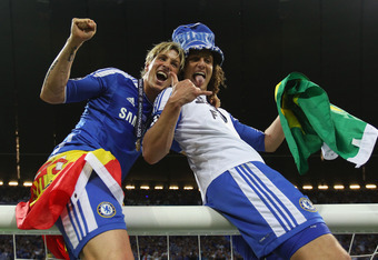 MUNICH, GERMANY - MAY 19:  David Luiz (R) and Fernando Torres of Chelsea celebrate after their victory in the UEFA Champions League Final between FC Bayern Muenchen and Chelsea at the Fussball Arena München on May 19, 2012 in Munich, Germany.  (Photo by A