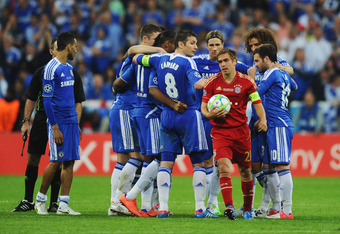 MUNICH, GERMANY - MAY 19:  Philipp Lahm of FC Bayern Muenchen walks through the Chelsea huddle during UEFA Champions League Final between FC Bayern Muenchen and Chelsea at the Fussball Arena München on May 19, 2012 in Munich, Germany.  (Photo by Mike Hewi