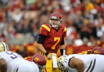 LOS ANGELES, CA - NOVEMBER 12:  Quarterback Matt Barkley #7 of the USC Trojans calls signals against the Washington Huskies at the Los Angeles Memorial Coliseum on November 12, 2011 in Los Angeles, California.  USC won 40-17.  (Photo by Stephen Dunn/Getty