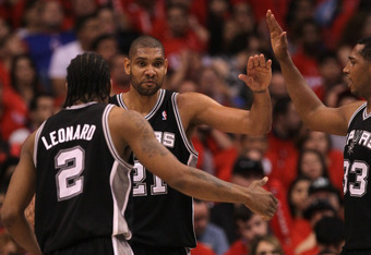 LOS ANGELES, CA - MAY 19:  Tim Duncan #21 of the San Antonio Spurs celebrates with Kawhi Loenard #2 and Boris Diaw #33 after making a basket and picking up a foul against the Los Angeles Clippers in Game Three of the Western Conference Semifinals in the 2