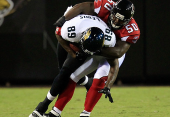 JACKSONVILLE, FL - AUGUST 19:  Marcedes Lewi #89 of the Jacksonville Jaguars is tackled by Curtis Lofton #50 of the Atlanta Falcons during a game at EverBank Field on August 19, 2011 in Jacksonville, Florida.  (Photo by Sam Greenwood/Getty Images)
