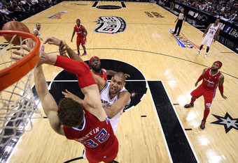 SAN ANTONIO, TX - MAY 17:  Tim Duncan #21 of the San Antonio Spurs takes a shot against Blake Griffin #32 of the Los Angeles Clippers in Game Two of the Western Conference Semifinals of the 2012 NBA Playoffs at AT&T Center on May 17, 2012 in San Antonio,