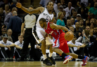 SAN ANTONIO, TX - MAY 15:  Chris Paul #3 of the Los Angeles Clippers drives on Kawhi Leonard #2 of the San Antonio Spurs in Game One of the Western Conference Semifinals in the 2012 NBA Playoffs at AT&T Center on May 15, 2012 in San Antonio, Texas. The Sp