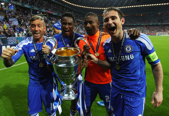 MUNICH, GERMANY - MAY 19: (L-R) Raul Meireles, John Obi Mikel, Salomon Kalou and Frank Lampard of Chelsea celebrate with the trophy after their victoryn in UEFA Champions League Final between FC Bayern Muenchen and Chelsea at the Fussball Arena München on