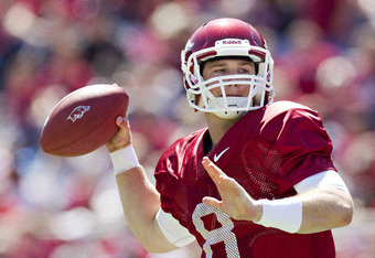 FAYETTEVILLE, AR - APRIL 21:   Quarterback Tyler Wilson #8 of the Arkansas Razorbacks Red Team throws a pass during the Spring Game at Donald W. Reynolds Stadium on April 21, 2012 in Fayetteville, Arkansas.  (Photo by Wesley Hitt/Getty Images)