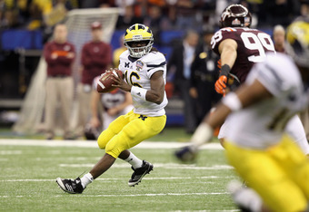 NEW ORLEANS, LA - JANUARY 03:  Denard Robinson #16 of the Michigan Wolverines looks to pass against the Virginia Tech Hokies during the Allstate Sugar Bowl at Mercedes-Benz Superdome on January 3, 2012 in New Orleans, Louisiana.  (Photo by Matthew Stockma