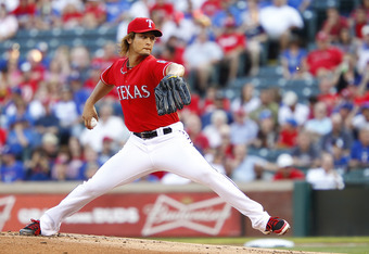 ARLINGTON, TX - MAY 16: Yu Darvish #11 of the Texas Rangers delivers a pitch against the Oakland Athletics at Rangers Ballpark in Arlington on May 16, 2012 in Arlington, Texas. (Photo by Rick Yeatts/Getty Images)