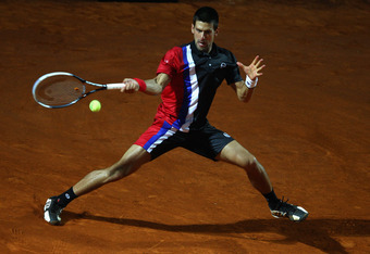 ROME, ITALY - MAY 19:  Novak Djokovic of Serbia plays a forehand in his match against Roger Federer of Switzerland during day eight of the Internazionali BNL d'Italia 2012 Tennis on May 19, 2012 in Rome, Italy.  (Photo by Julian Finney/Getty Images)