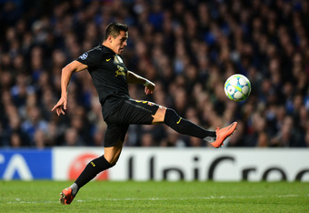 LONDON, ENGLAND - APRIL 18: Alexis Sanchez of Barcelona shoots at goal only to hit the bar during the UEFA Champions League Semi Final first leg match between Chelsea and Barcelona at Stamford Bridge on April 18, 2012 in London, England.  (Photo by Mike H