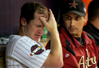 HOUSTON - OCTOBER 25:  Pitcher Roy Oswalt of the Houston Astros reacts in between innings in the dugout as he sits next to pitcher Andy Pettitte #21 against the Chicago White Sox during Game Three of the 2005 Major League Baseball World Series at Minute M