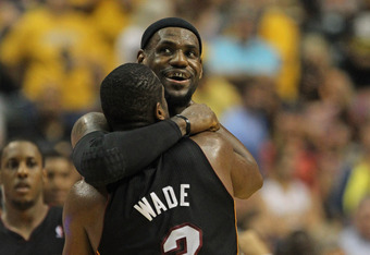 INDIANAPOLIS, IN - MAY 20:  LeBron James #6 of the Miami Heat hugs teammate Dwyane Wade #3 near the end of a win over the Indiana Pacers in Game Four of the Eastern Conference Semifinals in the 2012 NBA Playoffs at Bankers Life Fieldhouse on May 20, 2012
