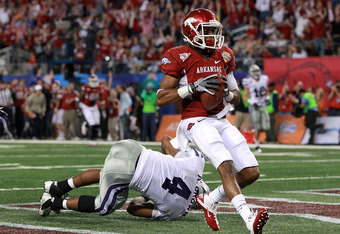 ARLINGTON, TX - JANUARY 06:  Jarius Wright #4 of the Arkansas Razorbacks makes a touchdown pass reception against Arthur Brown #4 of the Kansas State Wildcats during the Cotton Bowl at Cowboys Stadium on January 6, 2012 in Arlington, Texas.  (Photo by Ron