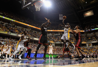 INDIANAPOLIS, IN - MAY 20: Darren Collison #2 of the Indiana Pacers goes up for a shot between Joel Anthony #50 and Shane Battier #31 of the Miami Heat in Game Four of the Eastern Conference Semifinals in the 2012 NBA Playoffs at Bankers Life Fieldhouse o