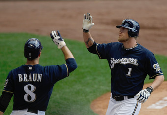 Ryan Braun and Corey Hart slap hands, presumably after something cool happened.