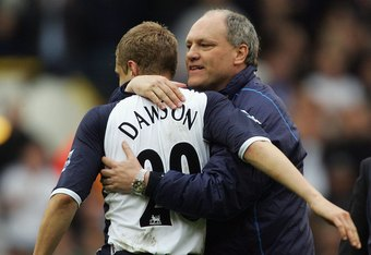 Then Tottenham manager Martin Jol congratulates Michael Dawson after a 1-0 win over Bolton in April 2006 that helped Tottenham back into European football.