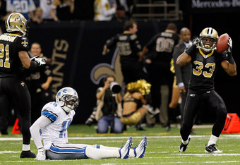 NEW ORLEANS, LA - JANUARY 07:  Jabari Greer #33 of the New Orleans Saints celebrates after an interception in the fourth quarter as Titus Young #16 of the Detroit Lions looks on during their 2012 NFC Wild Card Playoff game at Mercedes-Benz Superdome on Ja