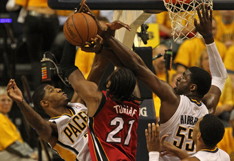 INDIANAPOLIS, IN - MAY 17: (L-R) Paul George #24, Roy Hibbert #55 and Danny Granger #33 of the Indiana Pacers pressure Ronny Turiaf #21 of the Miami Heat in Game Three of the Eastern Conference Semifinals in the 2012 NBA Playoffs at Bankers Life Fieldhous