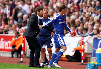 STOKE ON TRENT, ENGLAND - AUGUST 14:  Fernando Torres of Chelsea shakes hands with his manager Andre Villas-Boas as he is substituted in the second half during the Barclays Premier League match between Stoke City and Chelsea at the Britannia Stadium on Au