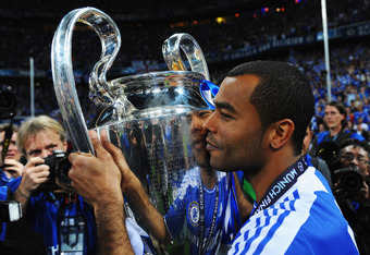 MUNICH, GERMANY - MAY 19:  Ashley Cole of Chelsea celebrates with the trophy after their victory in the UEFA Champions League Final between FC Bayern Muenchen and Chelsea at the Fussball Arena München on May 19, 2012 in Munich, Germany.  (Photo by Mike He
