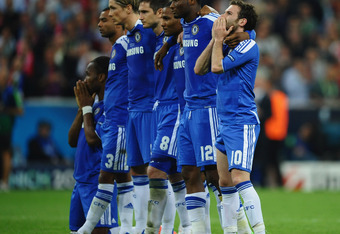 MUNICH, GERMANY - MAY 19:  Chelsea players look thoughtful during the penalty shoot out during UEFA Champions League Final between FC Bayern Muenchen and Chelsea at the Fussball Arena München on May 19, 2012 in Munich, Germany.  (Photo by Laurence Griffit