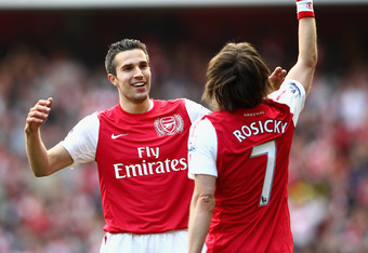 LONDON, ENGLAND - FEBRUARY 26: Robin van Persie of Arsenal congratulates scorer Tomas Rosicky during the Barclays Premier League match between Arsenal and Tottenham Hotspur at Emirates Stadium on February 26, 2012 in London, England.  (Photo by Clive Maso