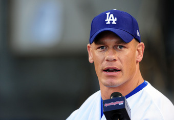 LOS ANGELES, CA - AUGUST 20:  WWE Superstar John Cena throws the ceremonial first pitch for the Los Angeles Dodgers as they play the Chicago Cubs on August 20, 2009 at Dodger Stadium in Los Angeles, California.  (Photo by Jacob de Golish/Getty Images)