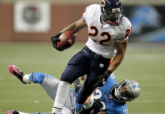 DETROIT, MI - OCTOBER 10:  Matt Forte #22 of the Chicago Bears breaks a tackle by Vincent Fuller #38 of the Detroit Lions during a second quarter run at Ford Field on October 10, 2011 in Detroit, Michigan.  (Photo by Gregory Shamus/Getty Images)