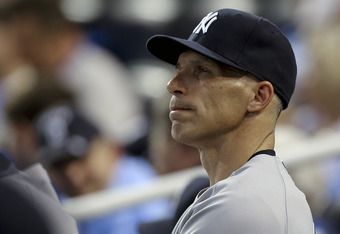 KANSAS CITY, MO - MAY 3:  Joe Girardi #28 manager of the New York Yankees watches his team play against the Kansas City Royals at Kauffman Stadium May 3, 2012 in Kansas City, Missouri. (Photo by Ed Zurga/Getty Images)