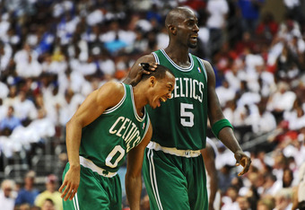 PHILADELPHIA, PA - MAY 18: Kevin Garnett #5 of the Boston Celtics comforts teammate Avery Bradley #0 as he winces in pain during the game against the Philadelphia 76ers in Game Four of the Eastern Conference Semifinals in the 2012 NBA Playoffs at the Well